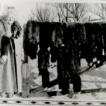 Image of Mrs. Graser with fox pelts
